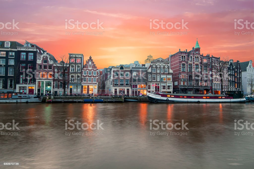 Amsterdam at the river Amstel at sunset in the Netherlands stock photo