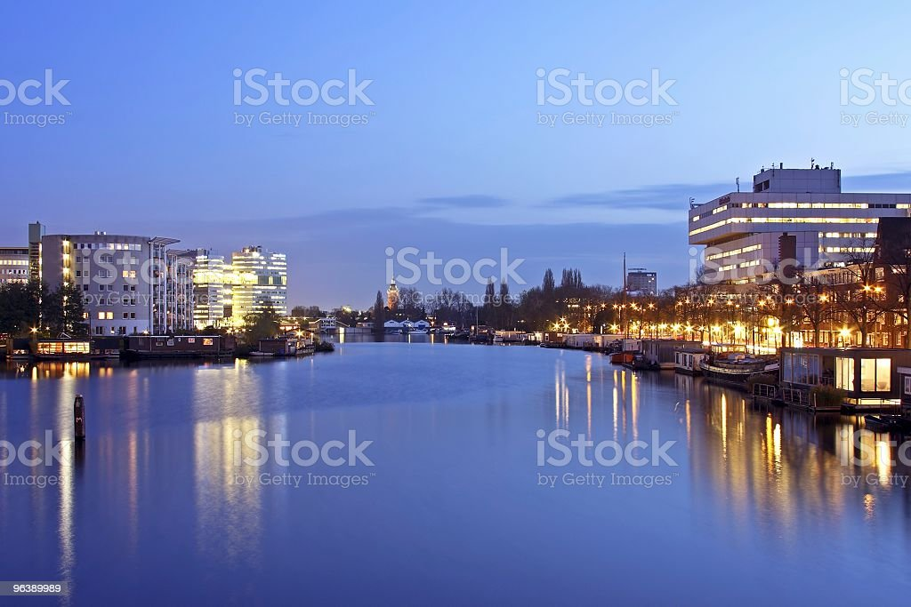 Amsterdam at twilight with the river Amstel in Netherlands - Royalty-free Amstel River Stock Photo