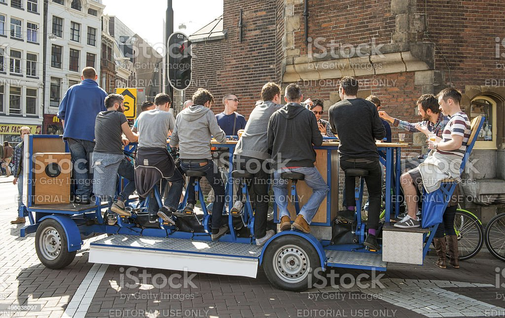 Amsterdam beer bike pub crawl stock photo