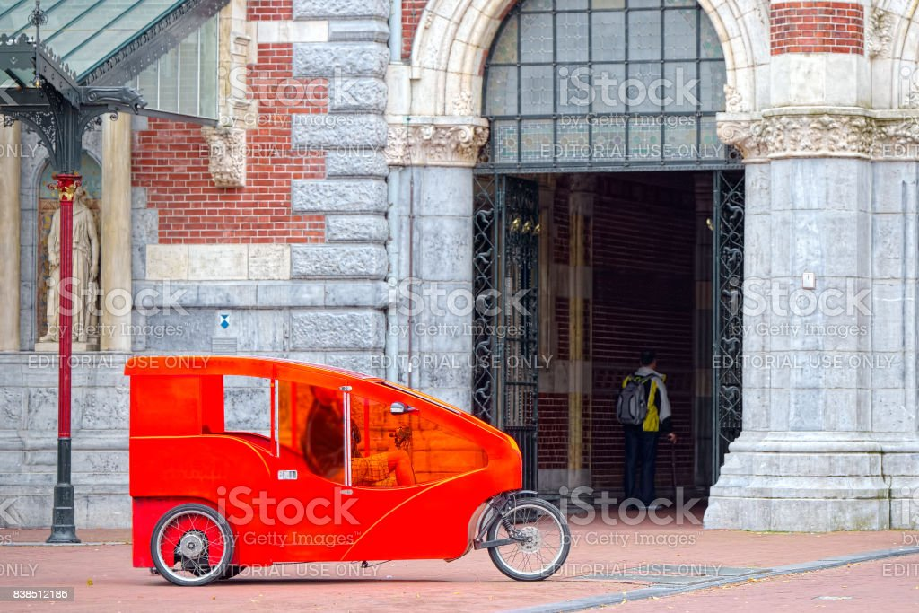 Amsterdam, bicycle red taxi in the historic center stock photo