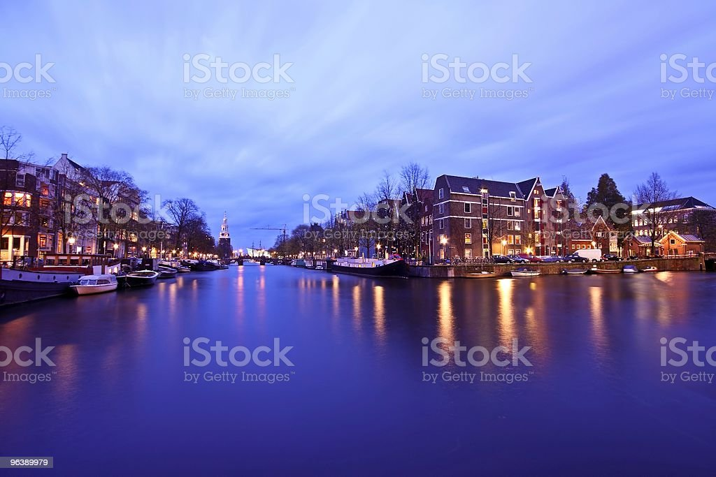 Amsterdam by night with the Montelbaantower in Netherlands - Royalty-free Amsterdam Stock Photo