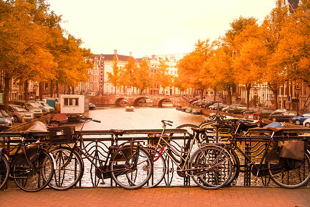 Amsterdam canal and bikes stock photo