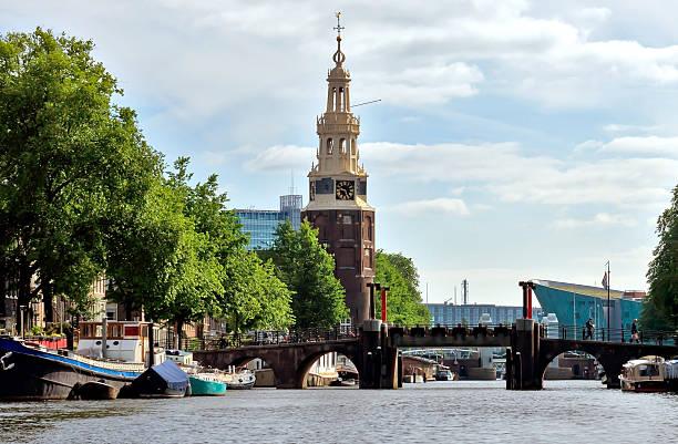amsterdam - canal and western church - westerkerk stockfoto's en -beelden