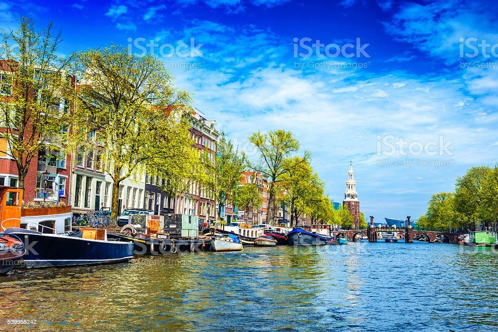 Amsterdam canal, Munttoren (tower) in Centrum stock photo