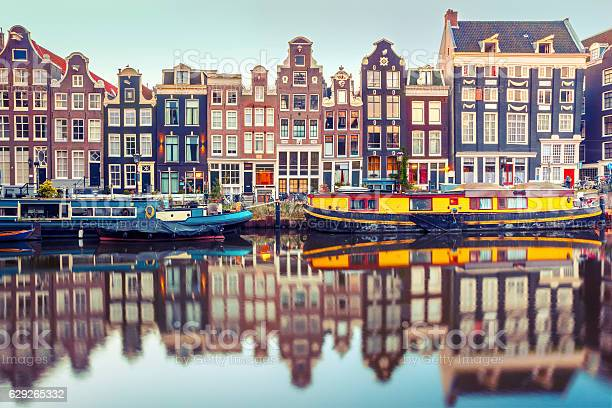 Photo of Amsterdam canal Singel with dutch houses