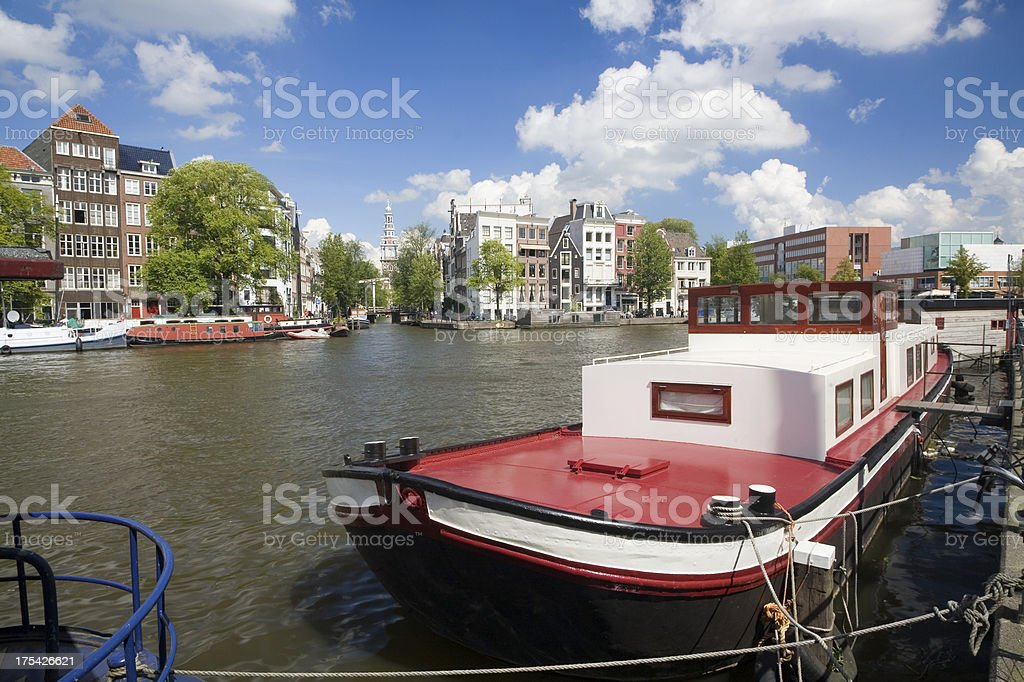 Amsterdam canal with houseboat stock photo