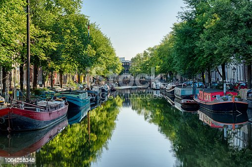 Amsterdam Canal with the Boat Houses and reflections