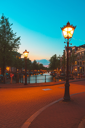 Amsterdam canals and houses against night cityscape of Amsterdam, Holland Netherlands