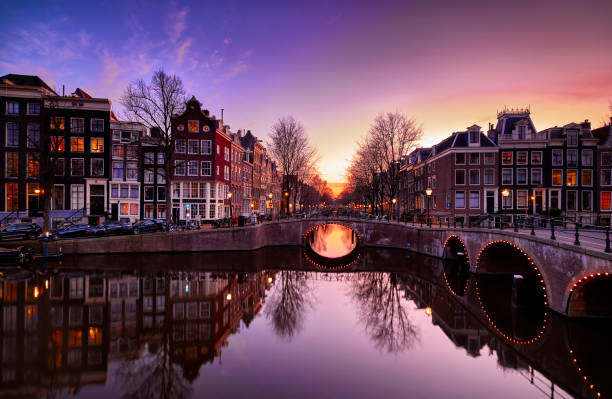 Amsterdam canals and typical canal houses at dusk stock photo