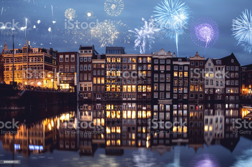 Amsterdam canals and typical houses in New Year's Eve night celebrations stock photo
