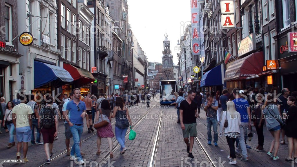 Amsterdam City Center,People,Public Transport Tram,Building Exterior,Retail Shop Scene In The Netherlands.Europe stock photo