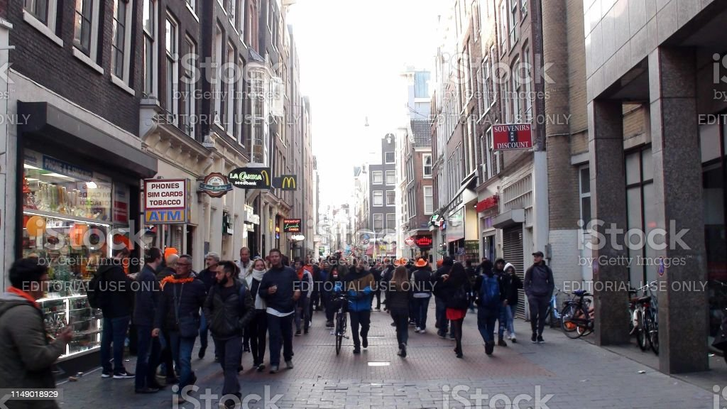View Of Advertisement Sign, Building Exterior, Retail Store, People...