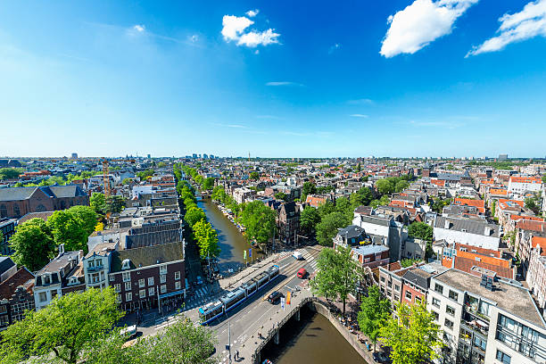 amsterdam city view from westerkerk, holland, netherlands. - westerkerk stockfoto's en -beelden