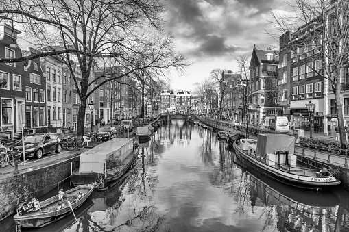 Amsterdam, NETHERLANDS - Dec 13, 2017: View on the beautiful old buildings and water channel in Amsterdam city