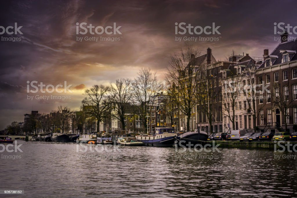 Amsterdam City's Streets and Canals on a cloudy day stock photo