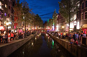 Amsterdam crowded city street in the red light district\n\nNote for inspectors: hope this works for the \