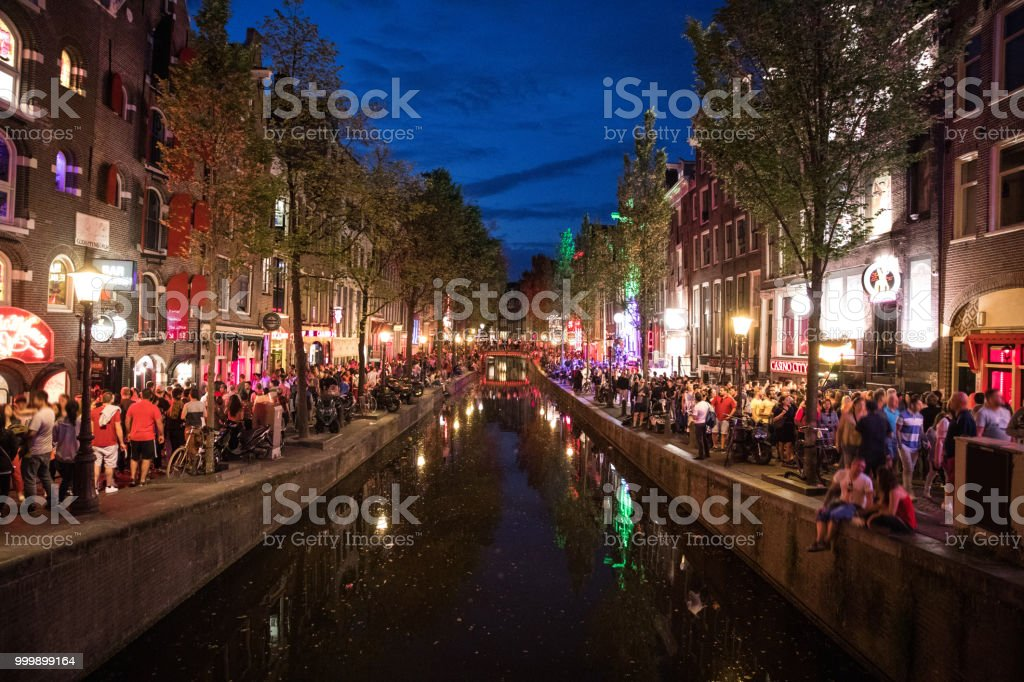 Amsterdam crowded city street in the red light district stock photo
