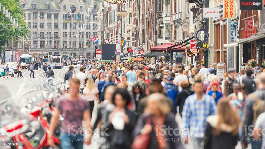 Amsterdam Damrak road stock photo