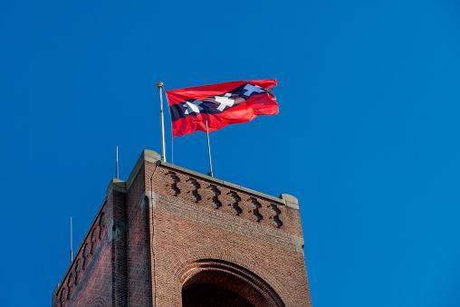 istock Amsterdam flag on Brick stone tower of Amsterdam stock market. 504649052