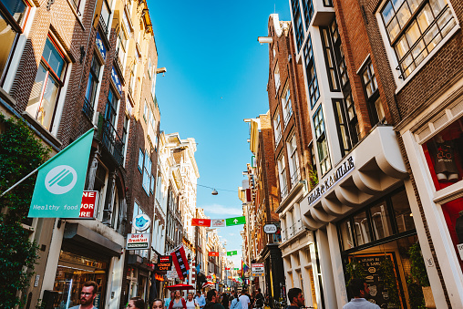 August 1st, 2020 – Amsterdam, Netherlands: Even during the Coronavirus, Amsterdam is still full of tourists and people on the street Nieuwendijk as you can see here in summer 2020.