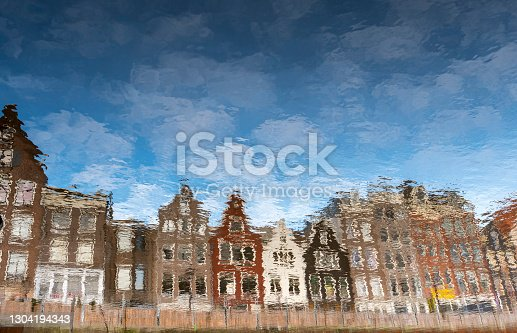 View on the canal, reflections of canal houses. in the historical centre of Amsterdam