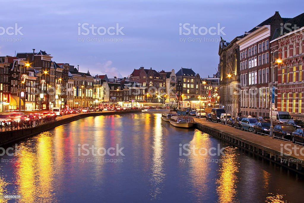 Amsterdam innercity at Damrak in the Netherlands by night - Royalty-free Amsterdam Stock Photo
