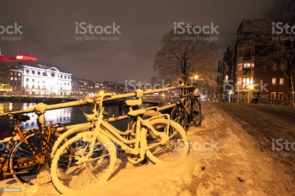 Amsterdam innercity at night the Netherlands covered in snow - Royalty-free Amsterdam Stock Photo