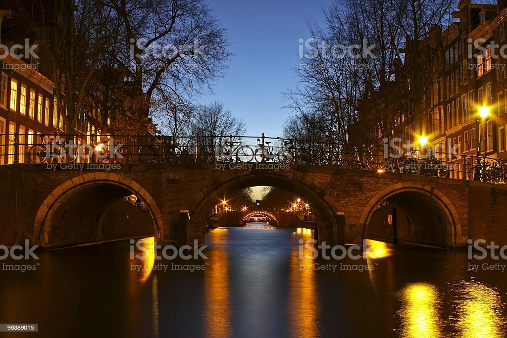 Amsterdam innercity by night in the Netherlands - Royalty-free Amsterdam Stock Photo