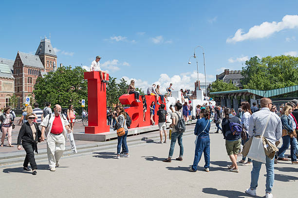 I Amsterdam letters. Located at Rijksmuseum, Amsterdam, Netherlands Amsterdam, Netherlands - Jun 27, 2015: Many tourists take a photo with the I Amsterdam letters. Located at Rijksmuseum. museumplein stock pictures, royalty-free photos & images