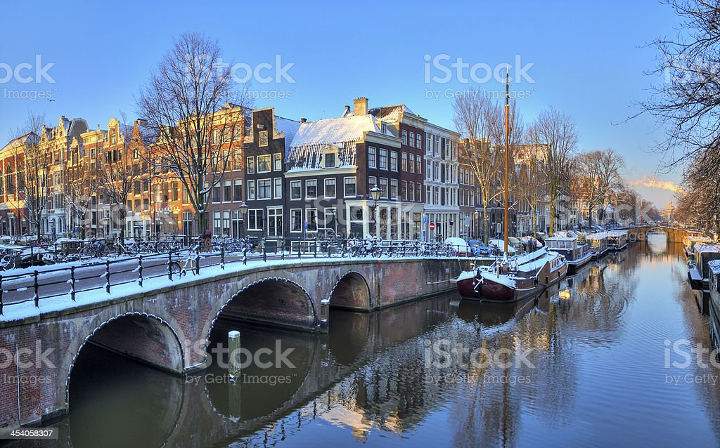 Amsterdam morning canal bridge stock photo
