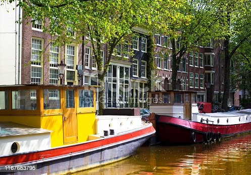 Amsterdam, Netherlands: Canal and Colorful Houseboats in Springtime