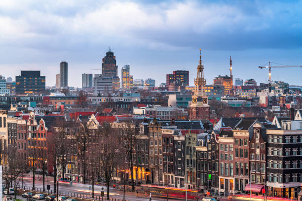 Amsterdam, Netherlands historic cityscape with the modern Zuidas district in the distance stock photo
