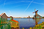 Amsterdam, Netherlands - May 04, 2016 - Traditional Dutch Windmills and little farm at riverside in Zaanse Schans.