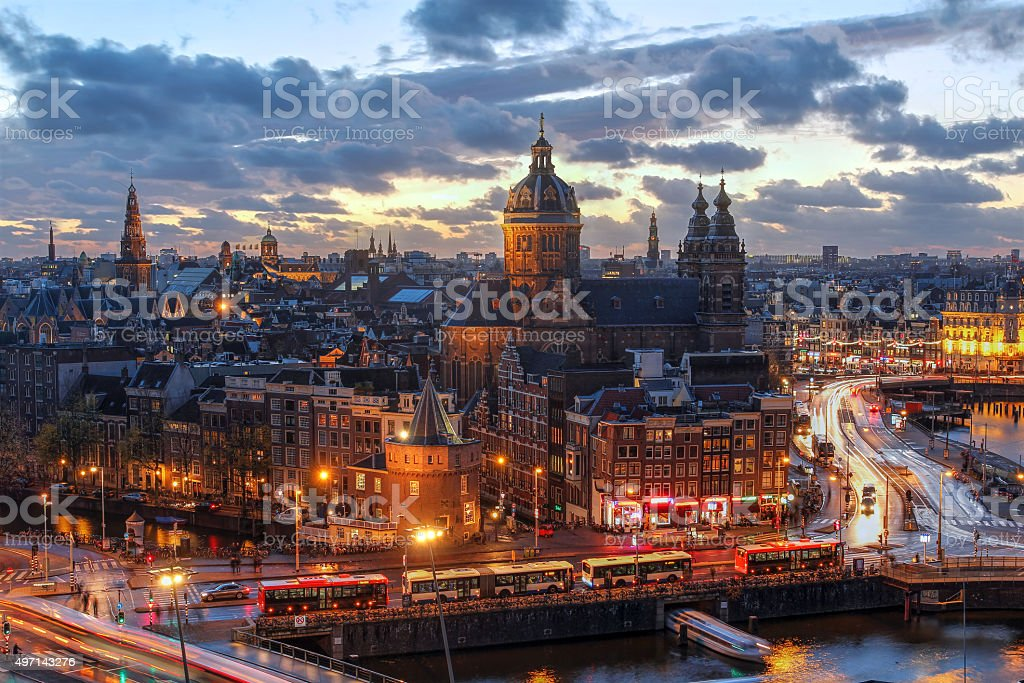 Amsterdam, Netherlands Aerial view of downtown Amsterdam, The Netherlands during a dramatic beautiful sunset. Almost all of the most proeminent landmarks are visible. 2015 Stock Photo
