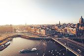 Amsterdam, Netherlands - December 28, 2014: Overlooking amsterdams old town in the morning sun.