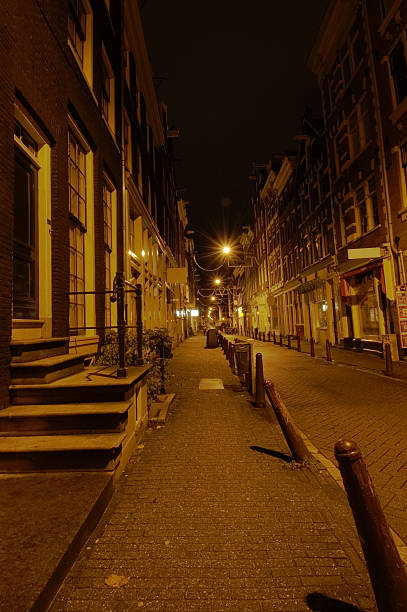 Amsterdam @ Night A side street in Amsterdam in the wee morning hours. aegis stock pictures, royalty-free photos & images