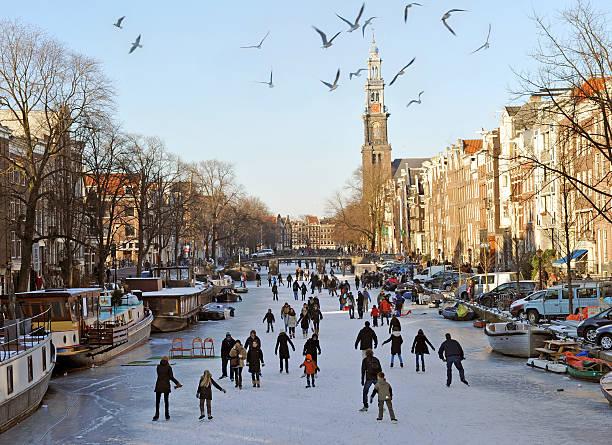 amsterdam on ice - westerkerk stockfoto's en -beelden