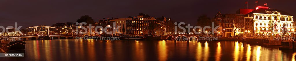 Amsterdam panorama with the Thiny bridge at night in Netherlands stock photo