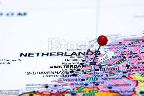 1151956281 istock photo Amsterdam pinned on a map of europe 525381285