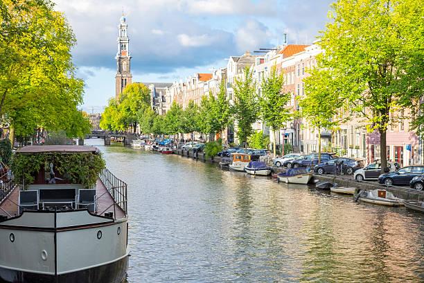 amsterdam prinsengracht canal view with the westerkerk - westerkerk stockfoto's en -beelden