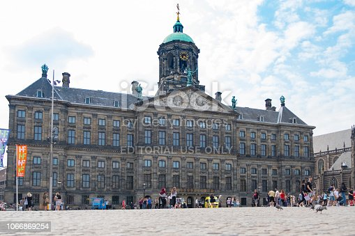 Amsterdam, Royal Palace on the Dam, low angle view with people walking on the square