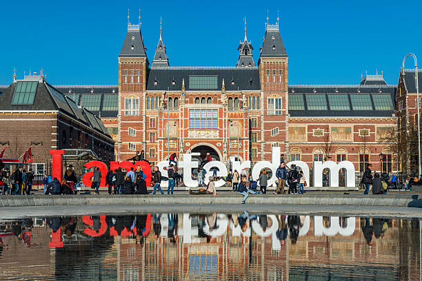 I amsterdam sign at Museumplein, Rijksmuseum in the back Amsterdam, the Netherlands - March 12, 2014: I amsterdam sign at Museumplein, Rijksmuseum in the back rijksmuseum stock pictures, royalty-free photos & images