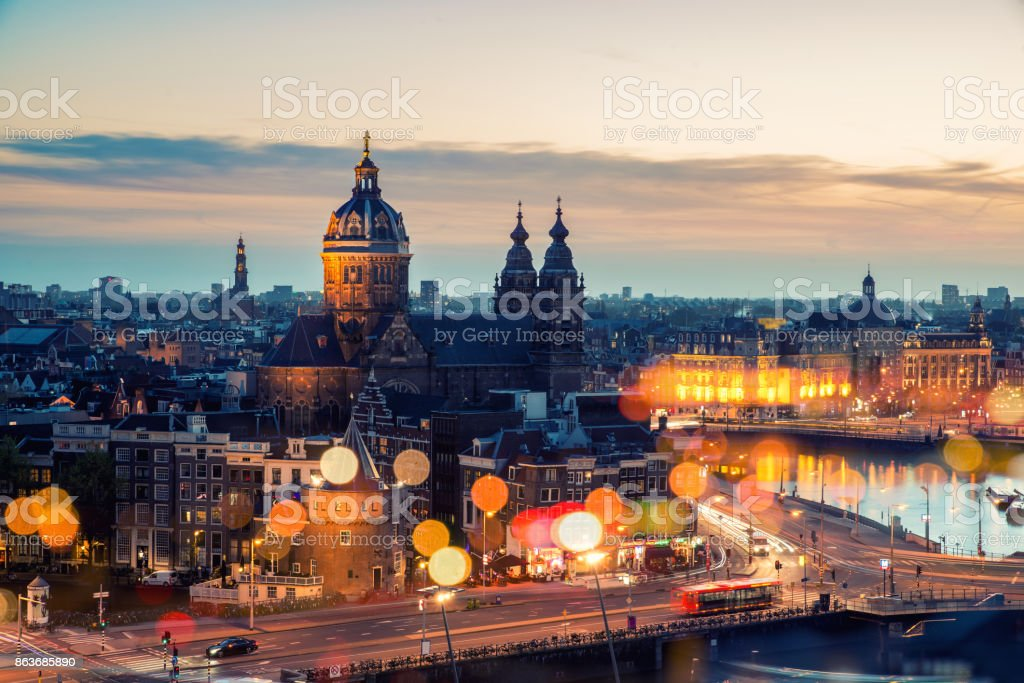 Amsterdam skyline in historical area at night, Netherlands. Ariel view of Amsterdam, Netherlands. stock photo