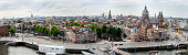 A Panoramic view of the Amsterdam Skyline, facing the south direction, featuring the canals, Westerkerk, Royal Palace and the Church of Saint Nicholas