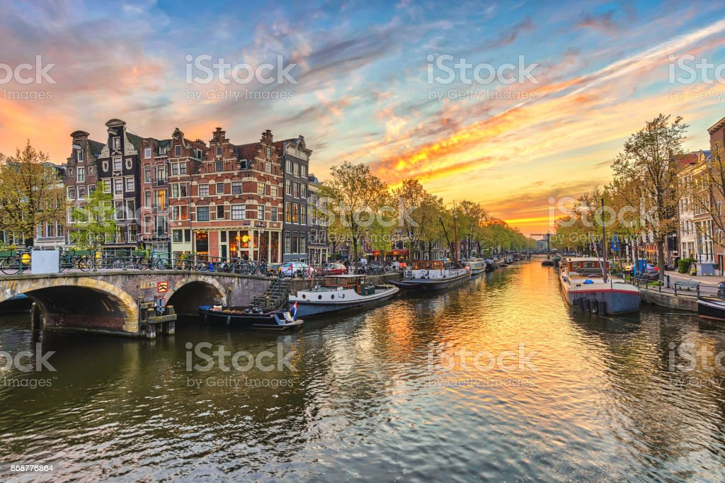 Amsterdam sunset city skyline at canal waterfront, Amsterdam, Netherlands stock photo