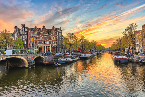 Amsterdam Sunset City Skyline At Canal Waterfront Amsterdam Netherlands Stock Photo - Download Image Now