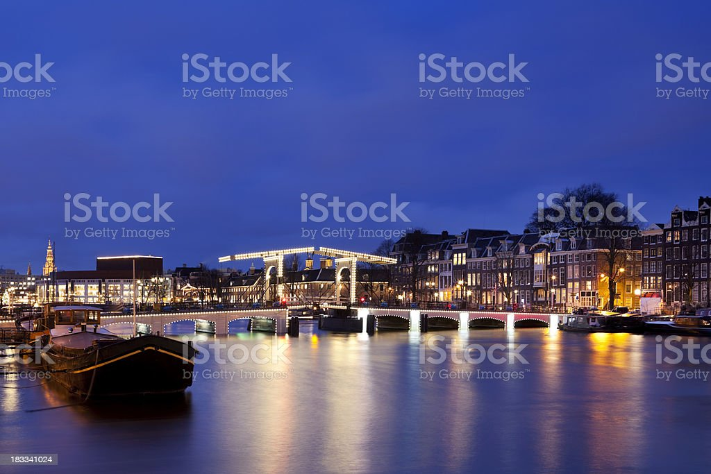 Amsterdam, The Netherlands and Amstel River at night royalty-free stock photo