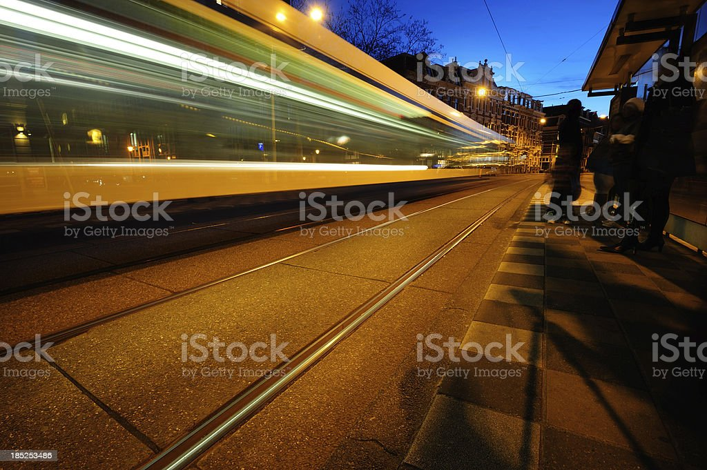 Amsterdam tram, motion blurred. By night. royalty-free stock photo