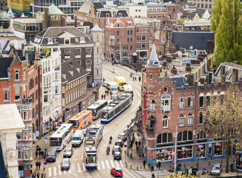 High angle view of traffic and pedestrians in central Amsterdam, Holland.