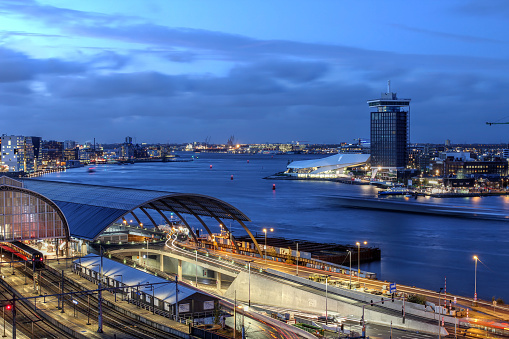 Skyline view of Amsterdam's waterfront facing the Ij River, with A'dam Toren and Amsterdam Eye.